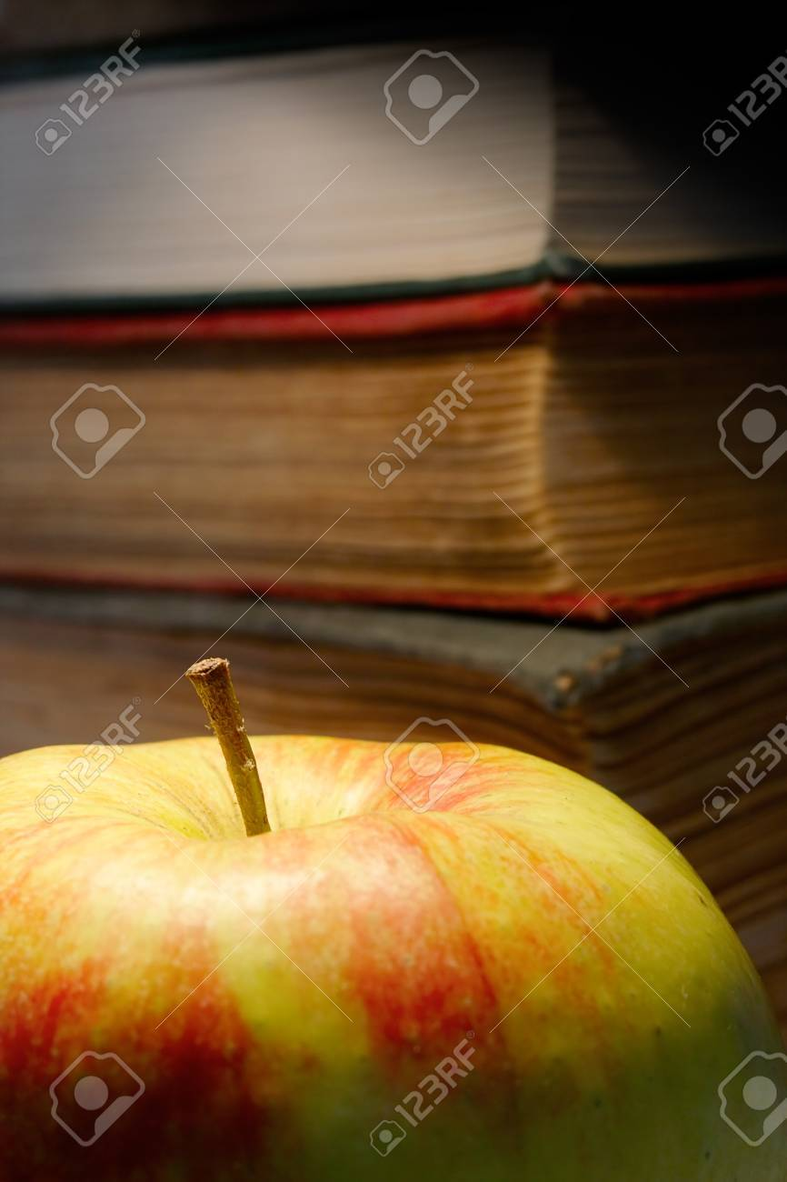 The old books and apple. Stock Photo - 9966758