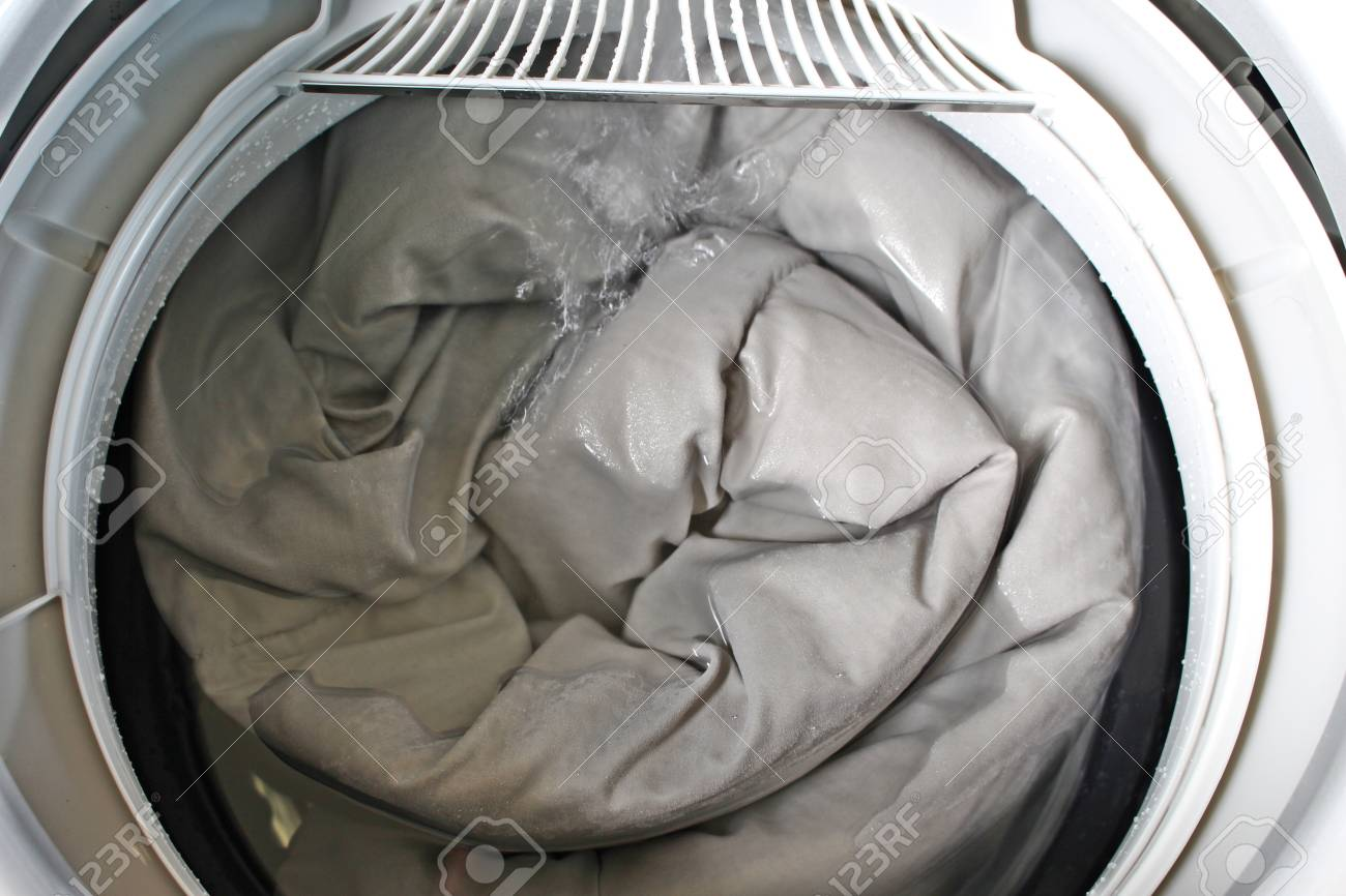 Roll Up The Duvet Put In A Washing Machine Stock Photo Picture