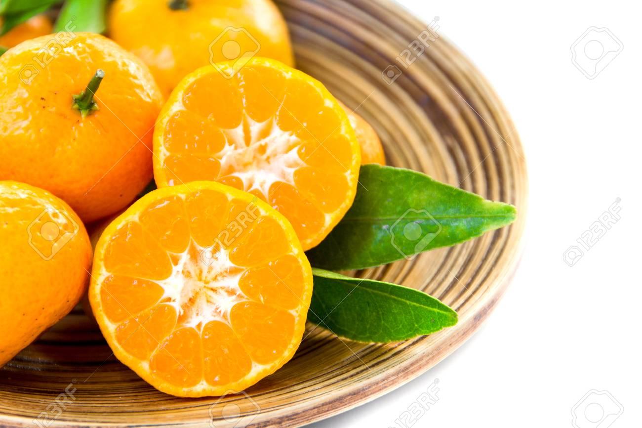 Fresh juicy tangerines in bowl Stock Photo - 25349203
