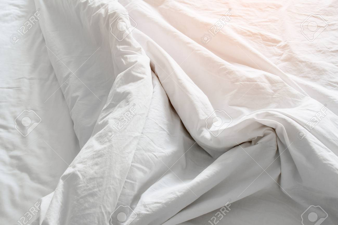 Bedding Sheets Crease,white Fabric In The Morning Stock Photo   96183666