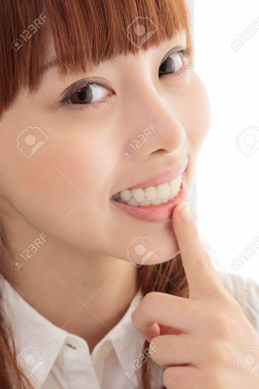 Young Asian women white teeth Stock Photo - 11700299