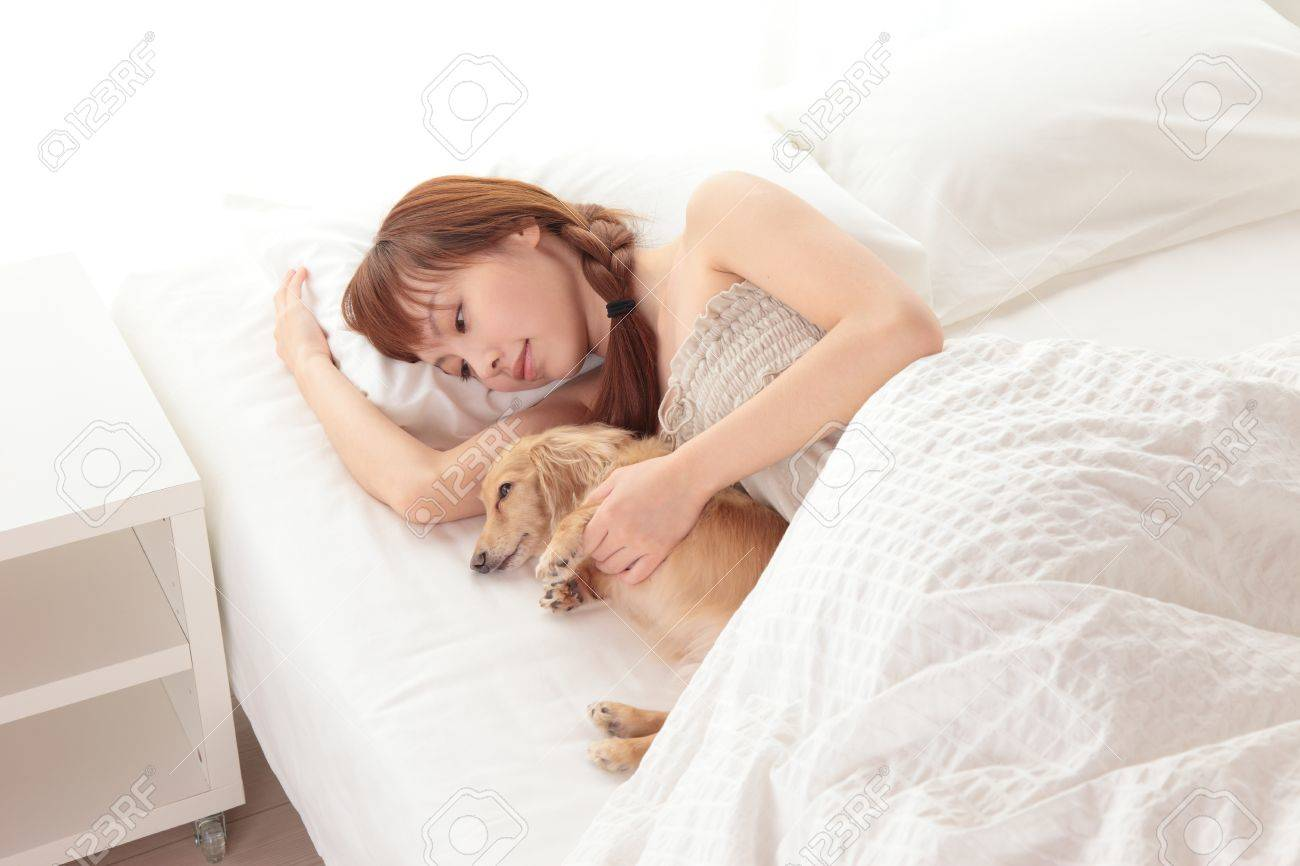 Beautiful young Asian woman sleeping on the bed Stock Photo - 12413341