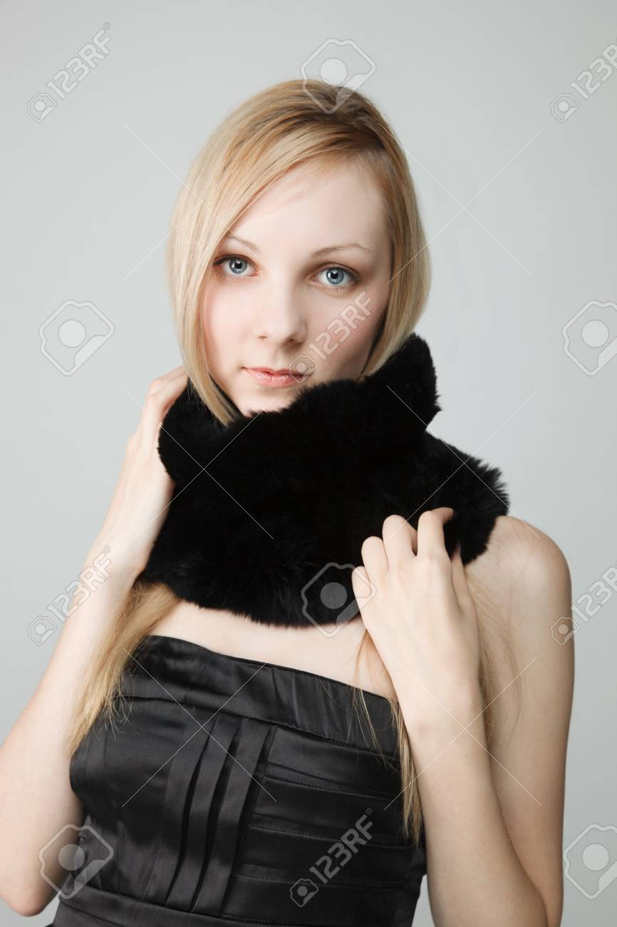 Portrait of woman with long black scarf, studio background Stock Photo - 15201903