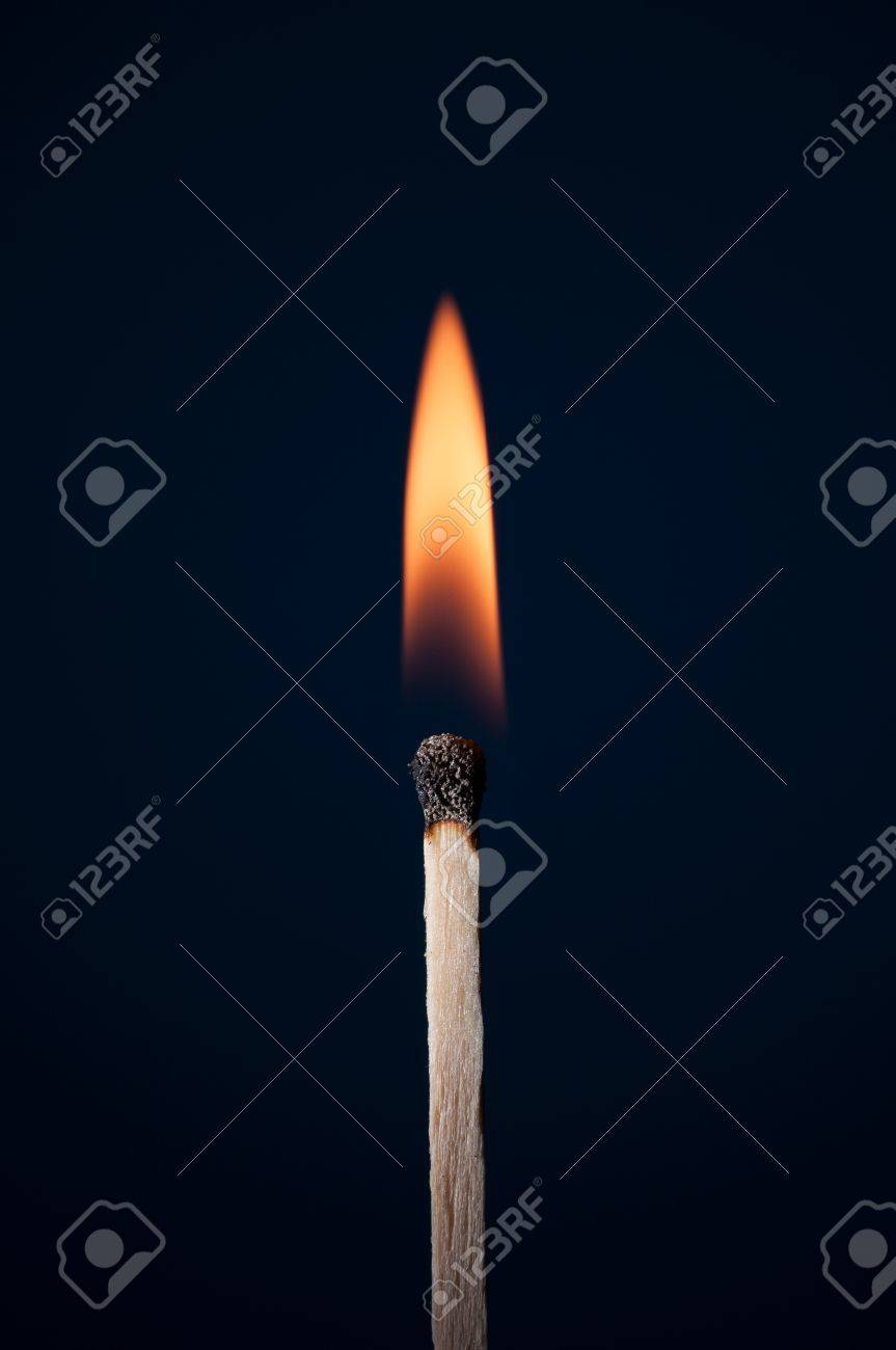 Match burning on a dark background - 19629079