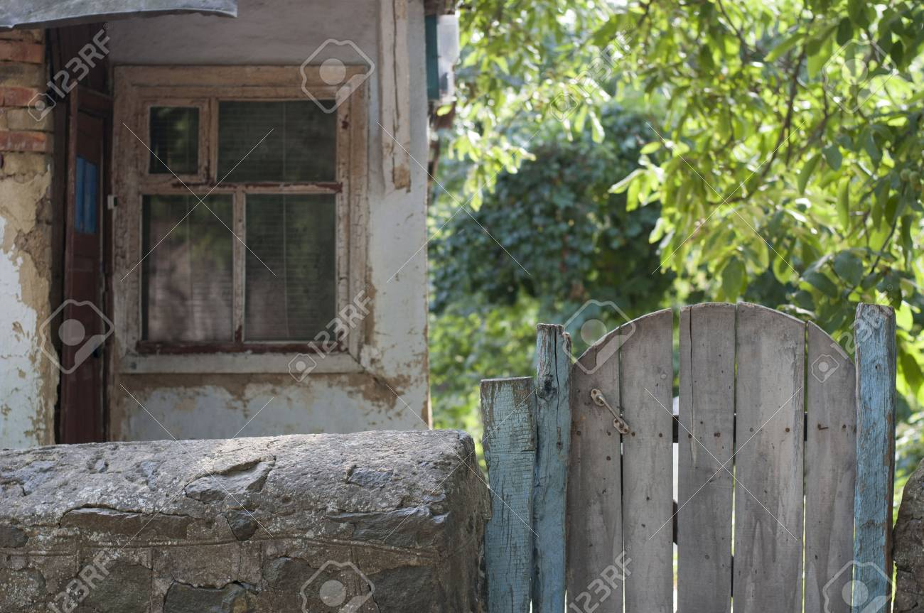 Old wooden gate in the yard - 44163459