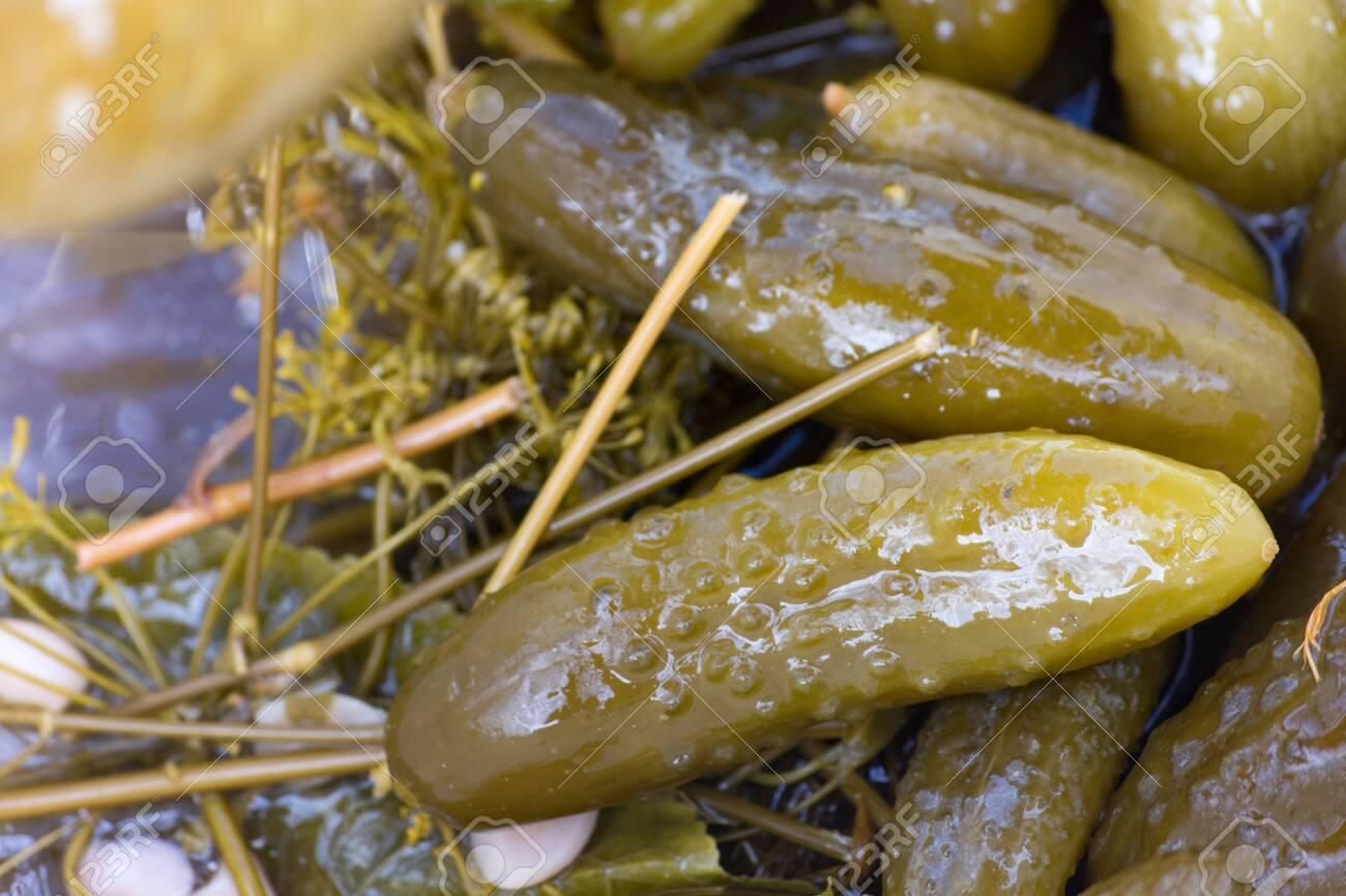 Pickled cucumber in marinade. Closeup. - 137314280