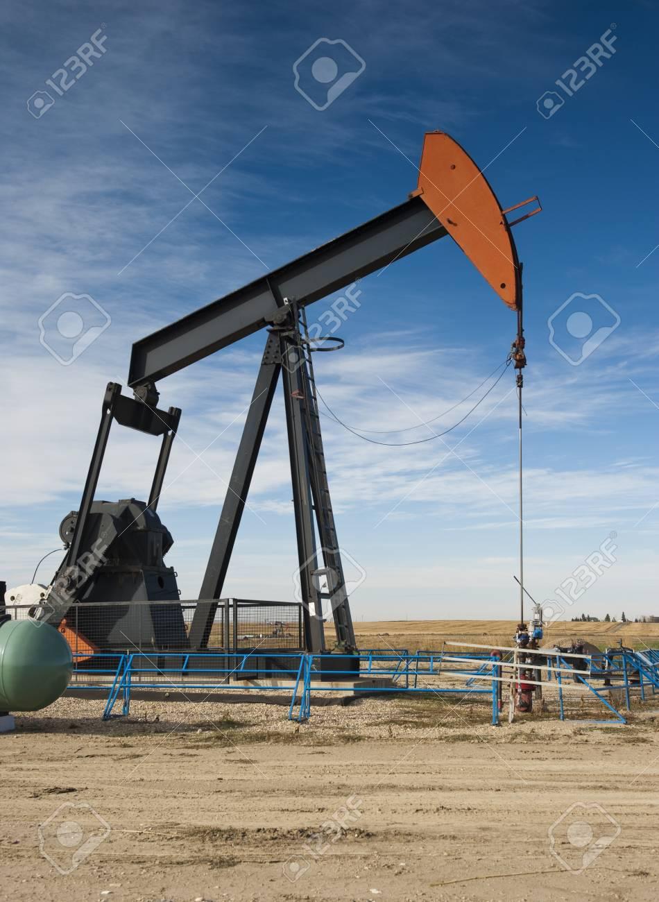 Oil pumpjack on a prairie landscape Stock Photo - 9666259