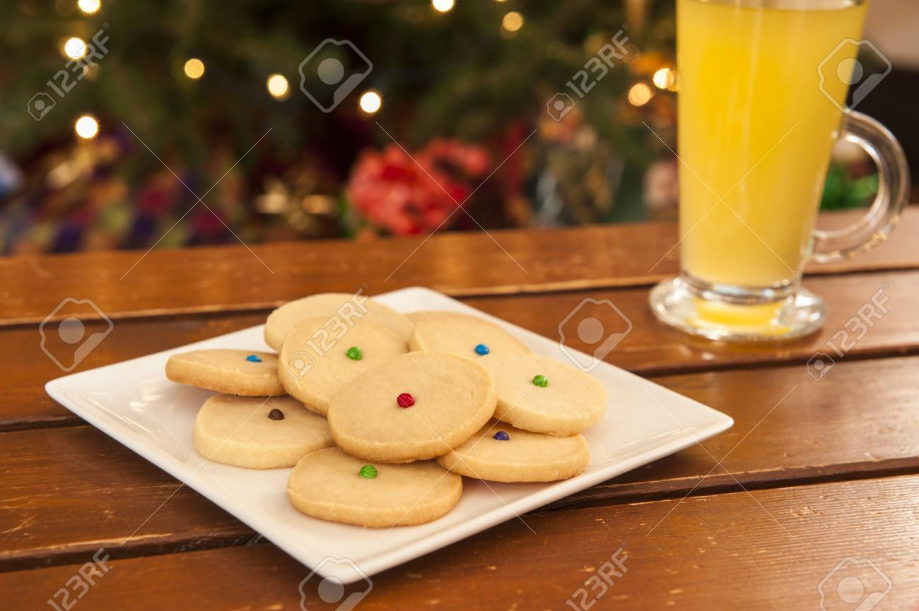 Plate Of Shortbread Cookies In Front Of The Christmas Tree