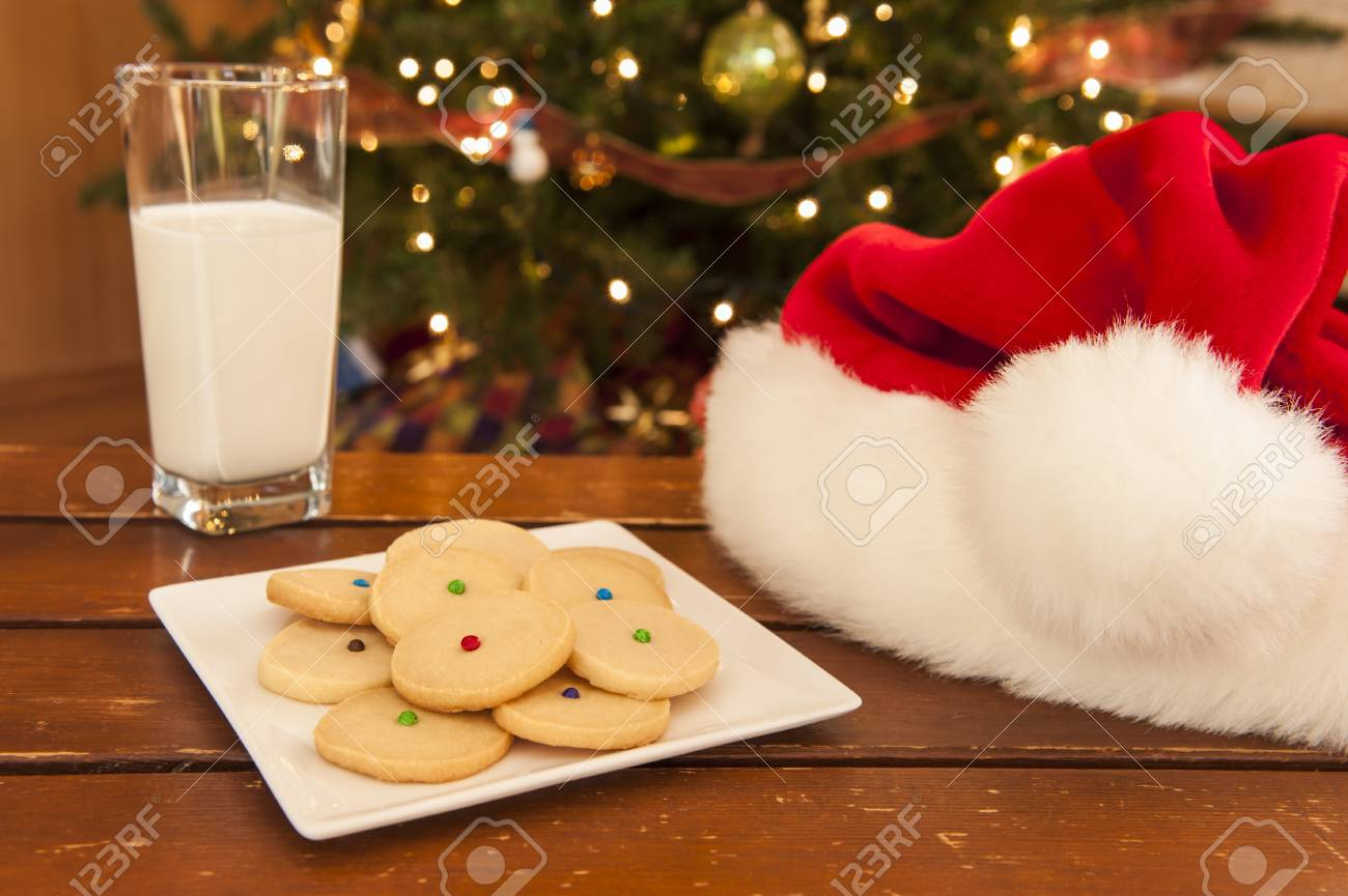 Plate Of Shortbread Cookies With A Glass Of Milk And Santa Hat