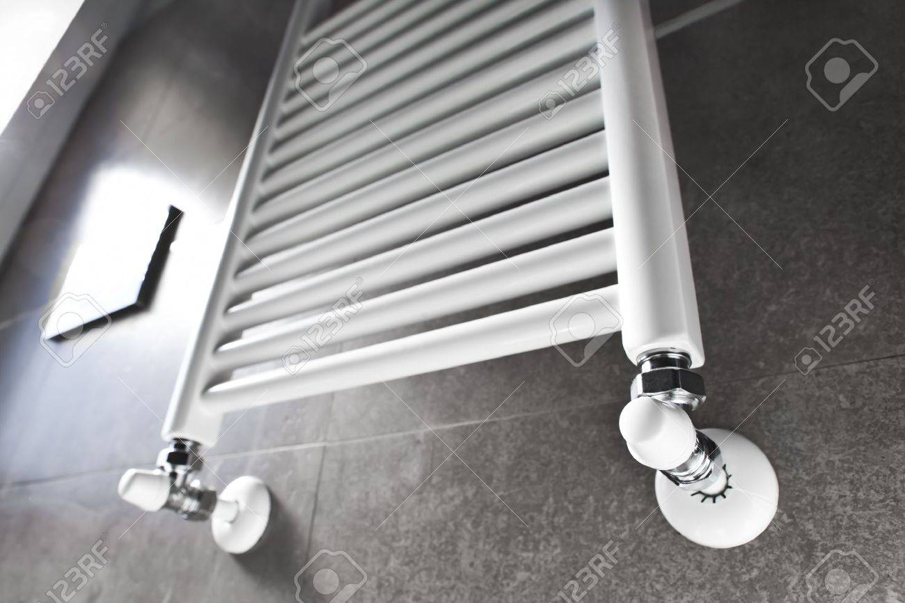 White bathroom heater lighted by the window Stock Photo - 16113302