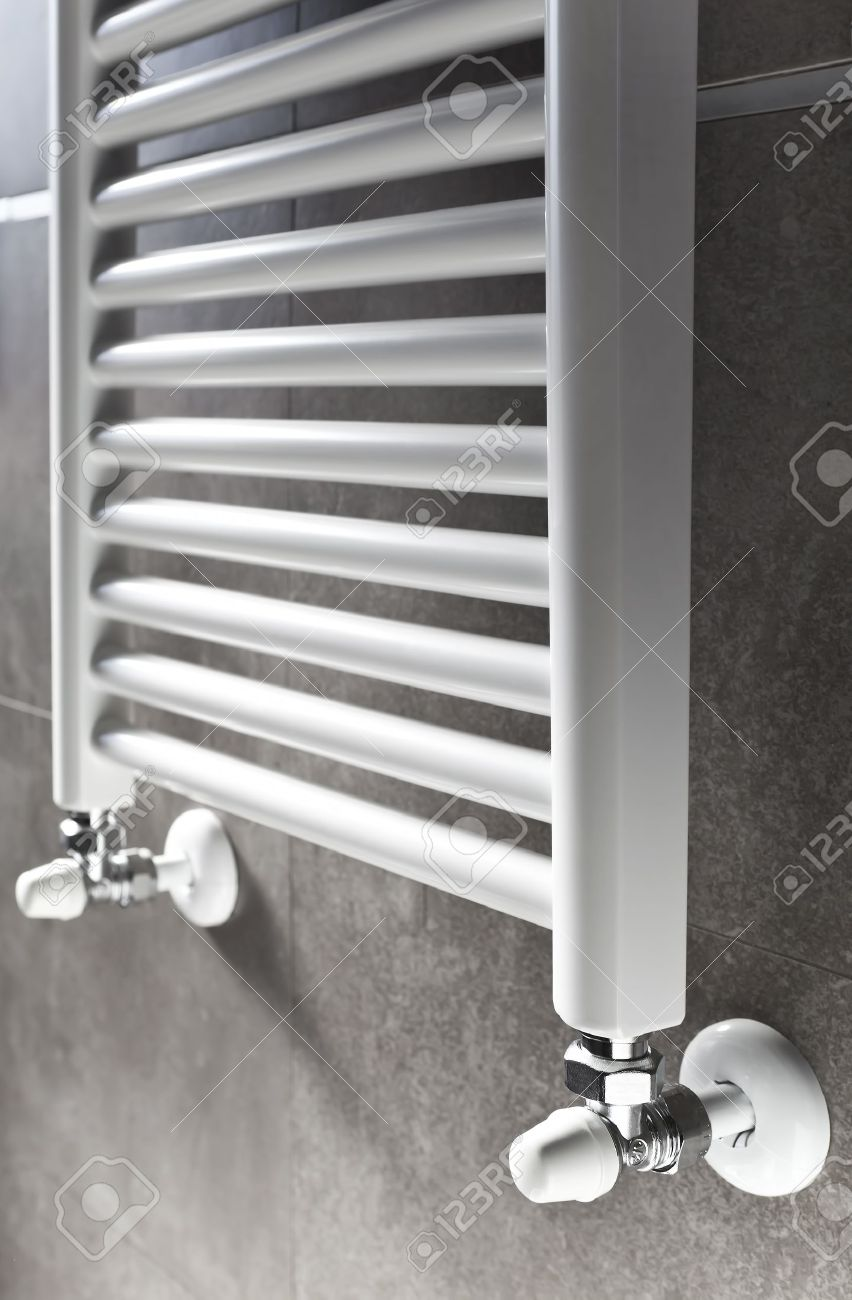 White Bathroom Heater Closeup On Gray Wall Stock Photo Picture