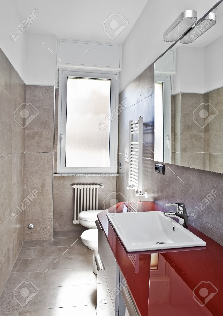 Red Bathroom With Toilette Bidet Heater Lavabo And Mirror Stock
