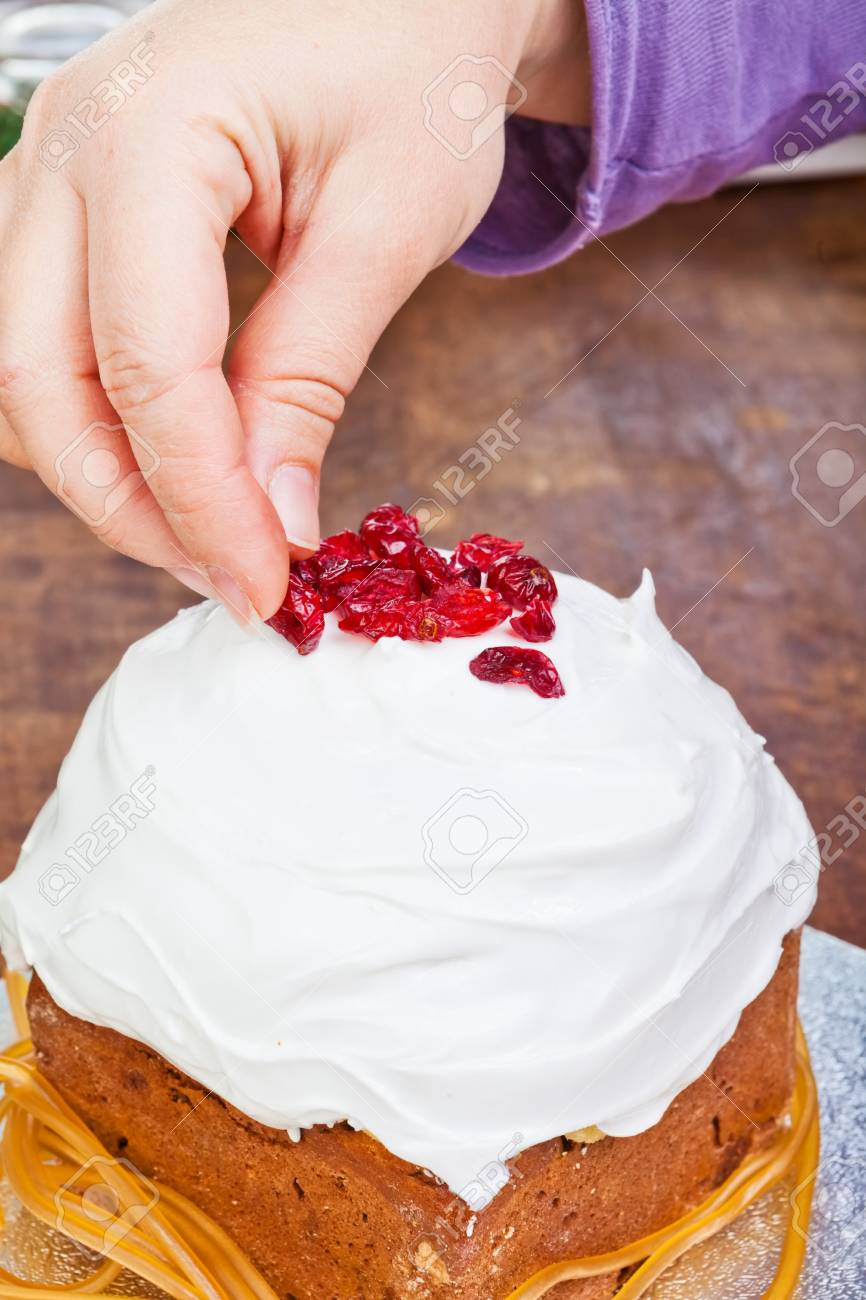 Christmas creamy cake decorated by hands with violet sleeve Stock Photo - 16945263