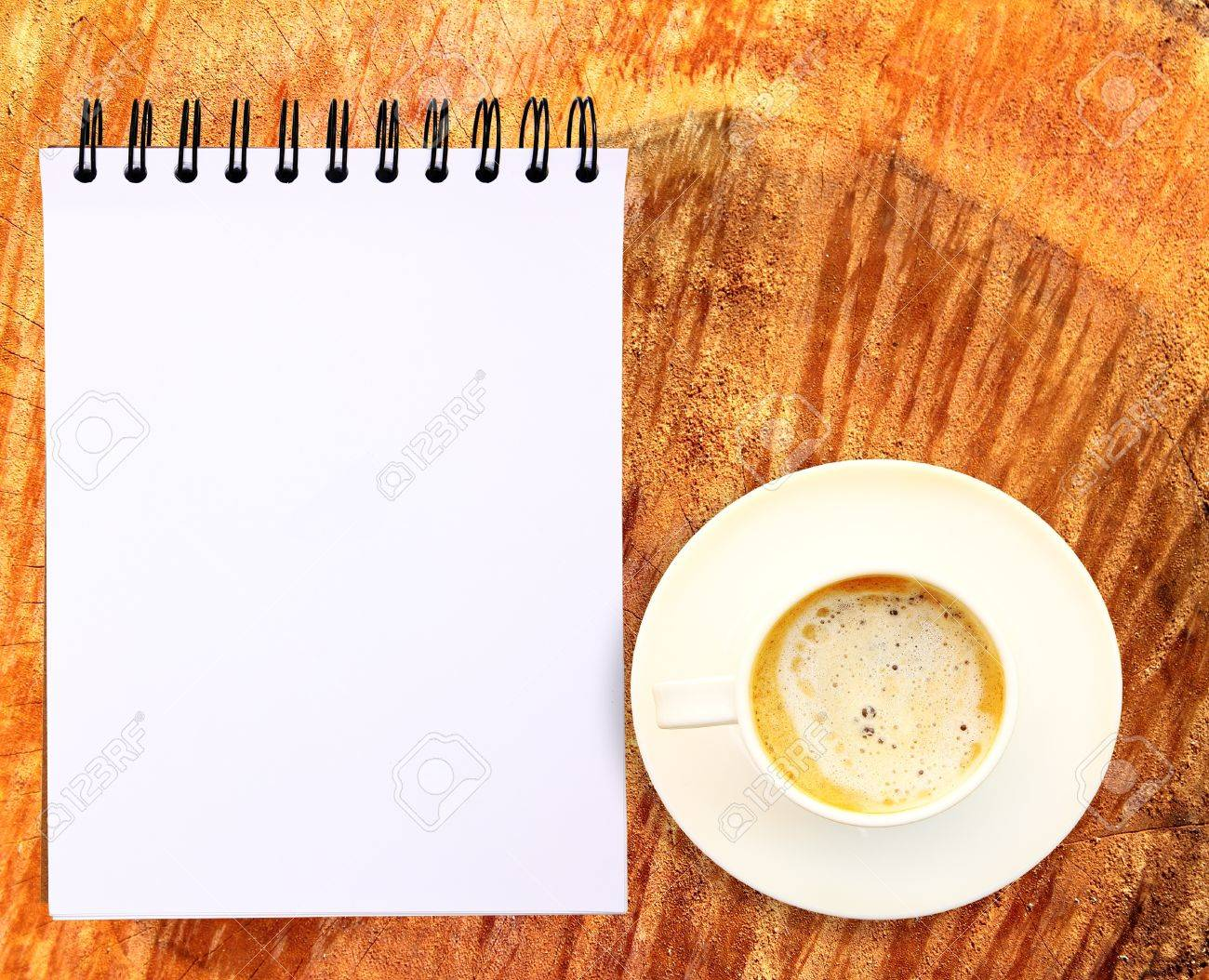 Blank paper tablet with coffee cup on wood background Stock Photo - 11030454