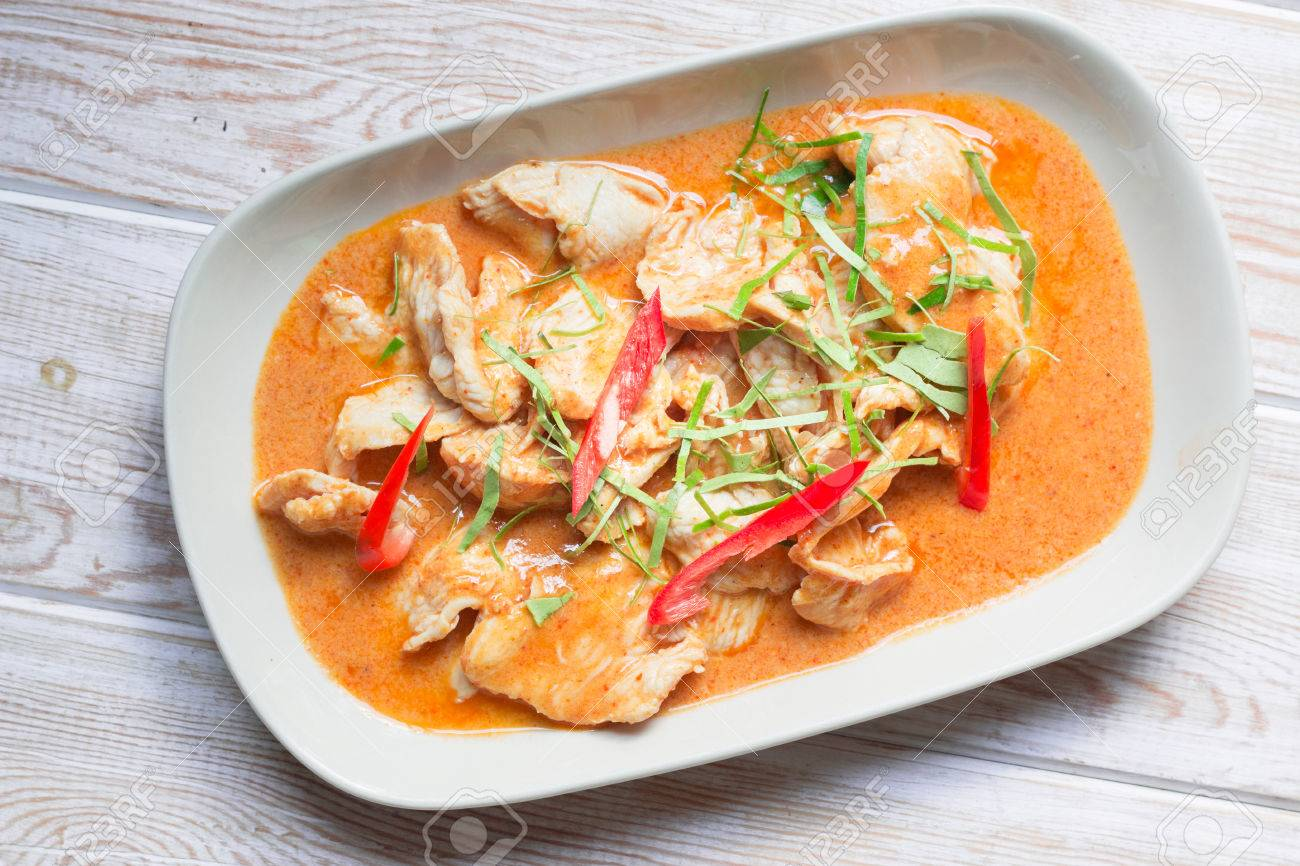 c10c7d74 Top View, Spicy Thai Food Red Curry Chicken On Wood Stock Photo ...