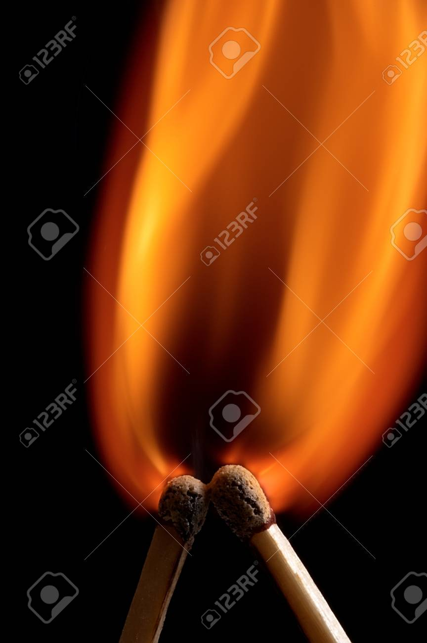 Two burning match on black background Stock Photo - 13155415