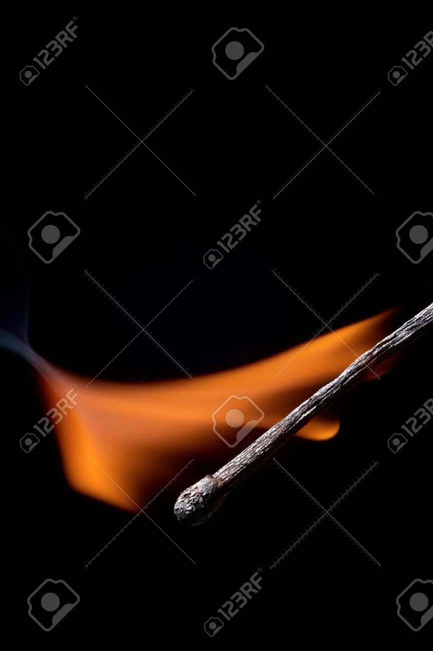 Burning matchstick on black background Stock Photo - 13298655