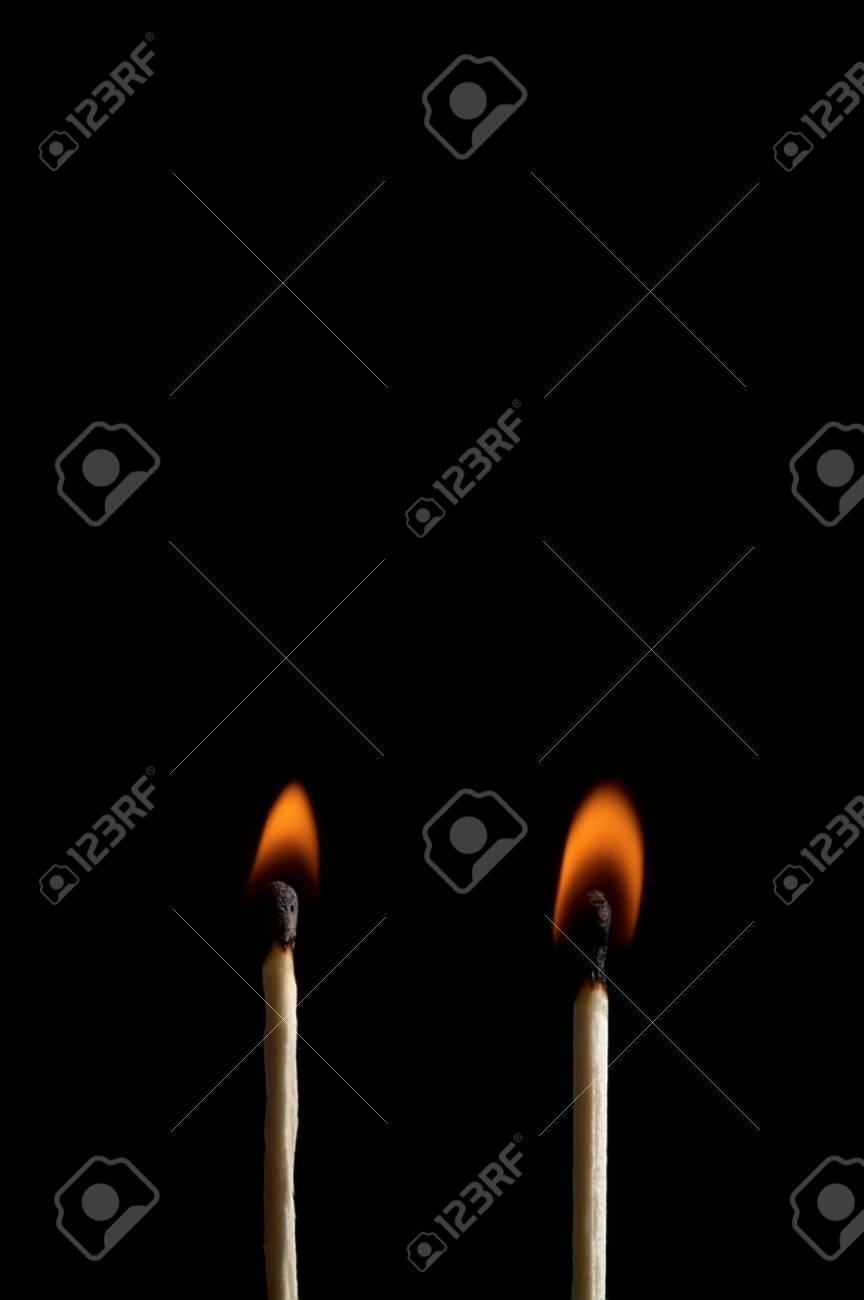 Burning matchstick on black background Stock Photo - 13298629