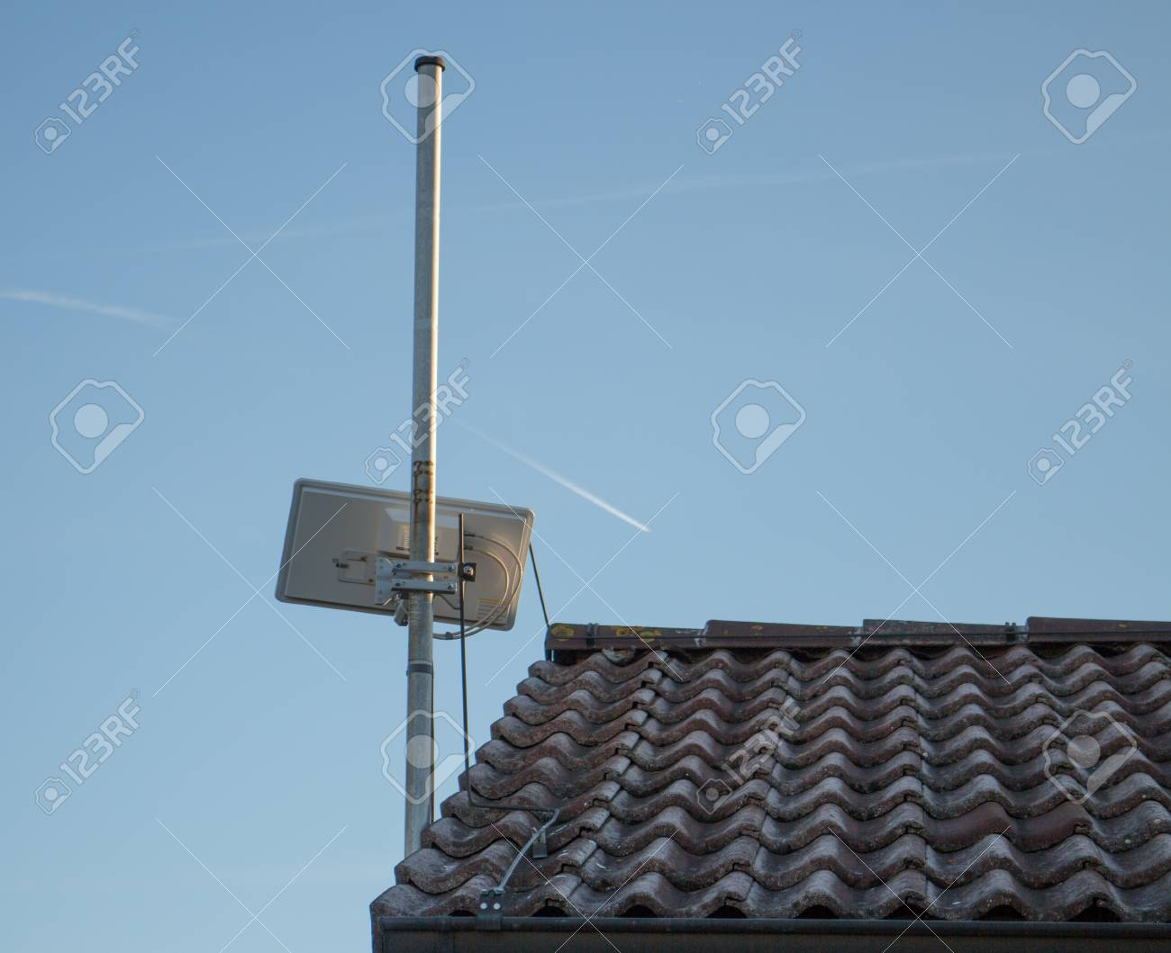 Small rectangle satellite and internet antenna on roof