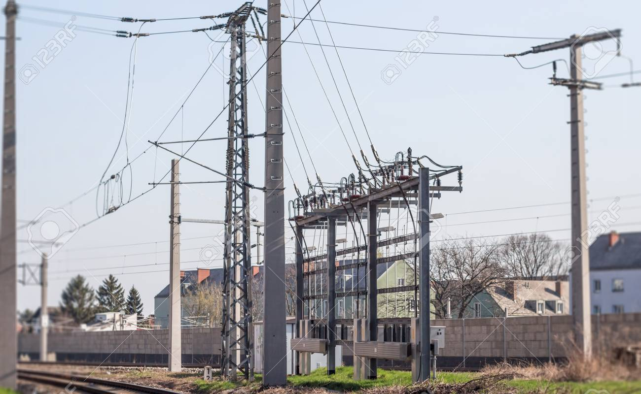 Electric Train power transmission poles and wires above tracks