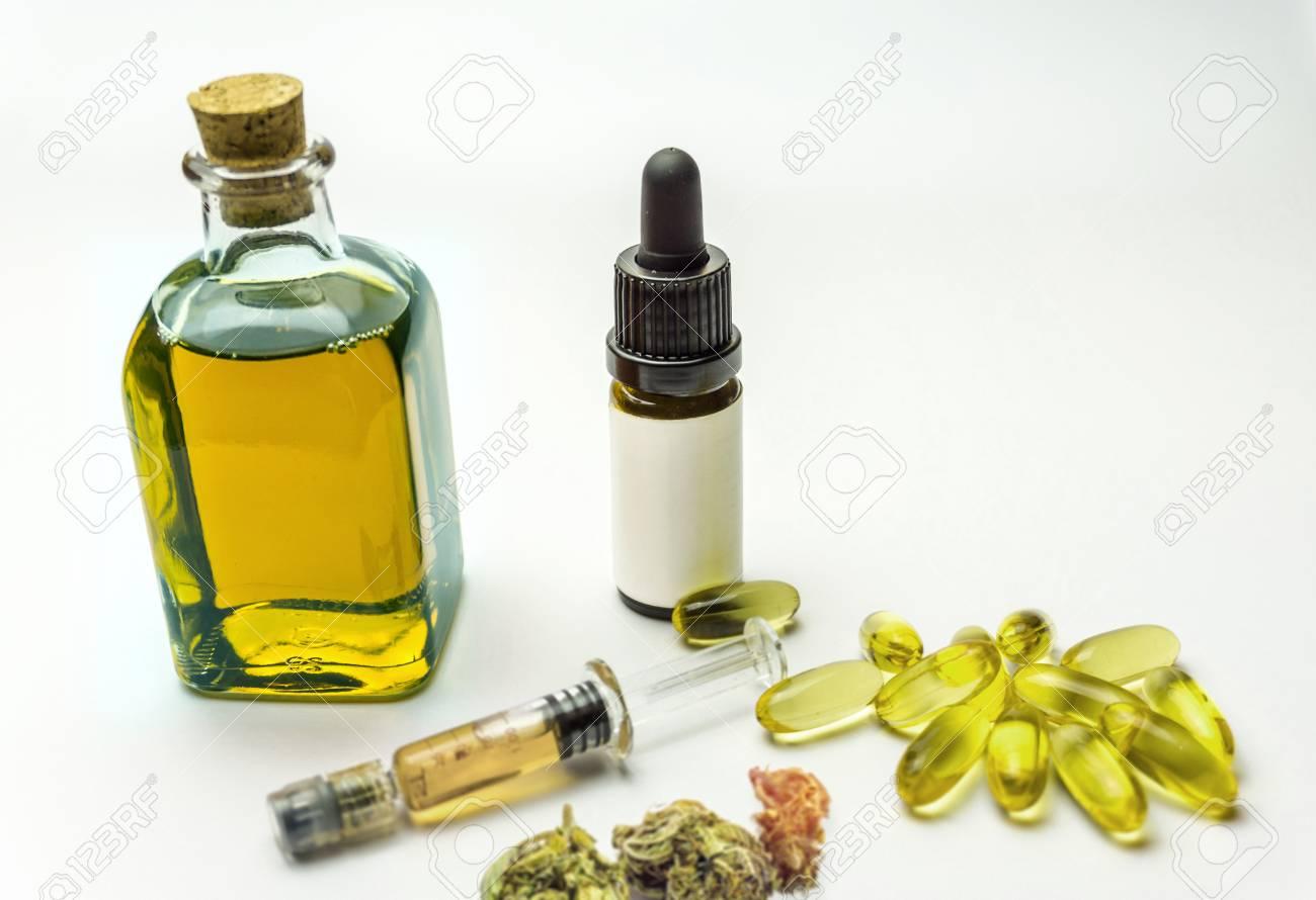 Cbd oil in glass bottles, syringe, hemp capsules and hemp flower