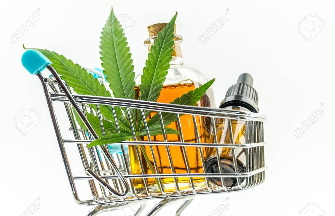 Supermarket trolley with marijuana leafs and medical cannabis oil cbd - 122303357