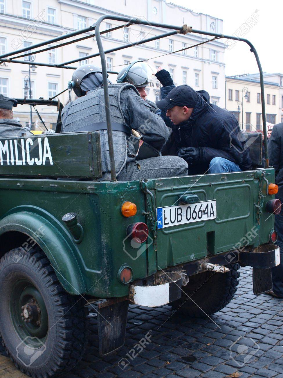 Celebrations of the 30th Anniversary of introducing the Martial Law In Poland on December 13th 1981: staging of the demonstrations against the introduction of the Martial Law, arrested opponents in ZOMO car, Lublin, Poland, Dec, 13th 2011. Stock Photo - 11482292