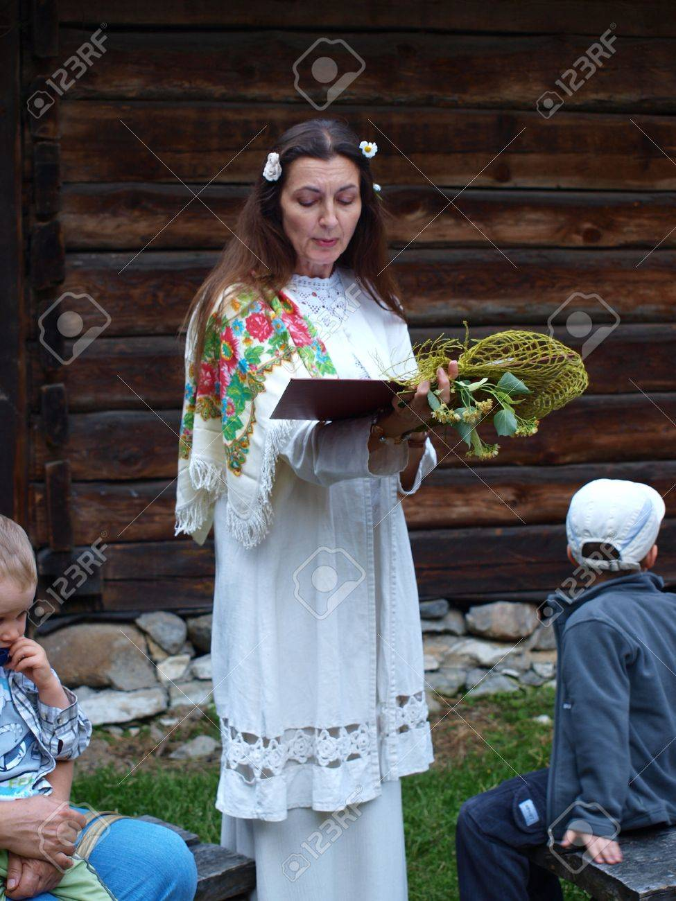Reading fairy tales and legends connected with the Night of St. John. Night of St. John, an old Polish (and Slavic) folk event, June 24th 2011, Open-Air Museum of the Lublin Region Village, Lublin, Poland Stock Photo - 12059474