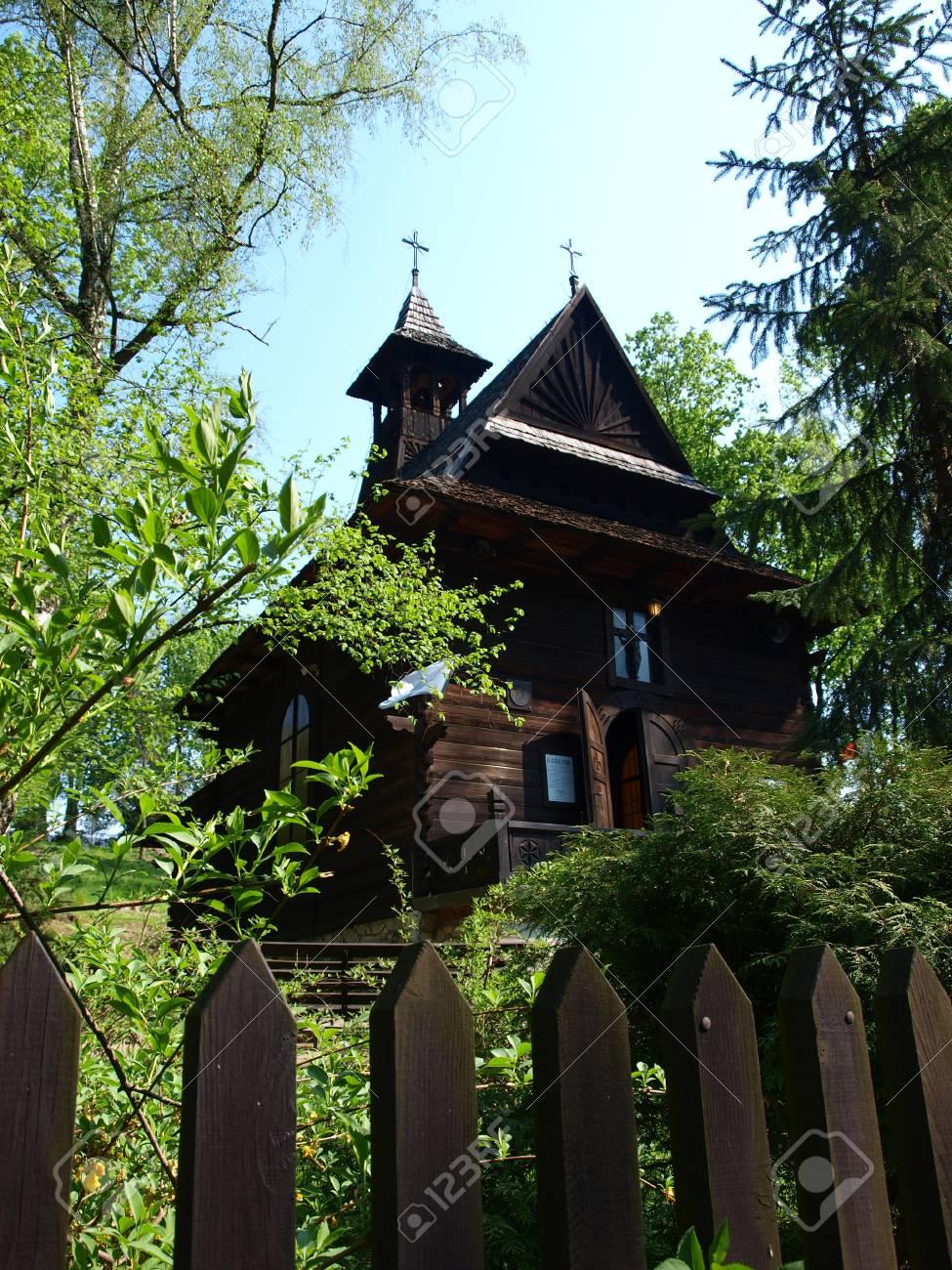 Zakopane-style wooden church of St  Charles Borromeo, Naleczow, Poland Stock Photo - 14592419