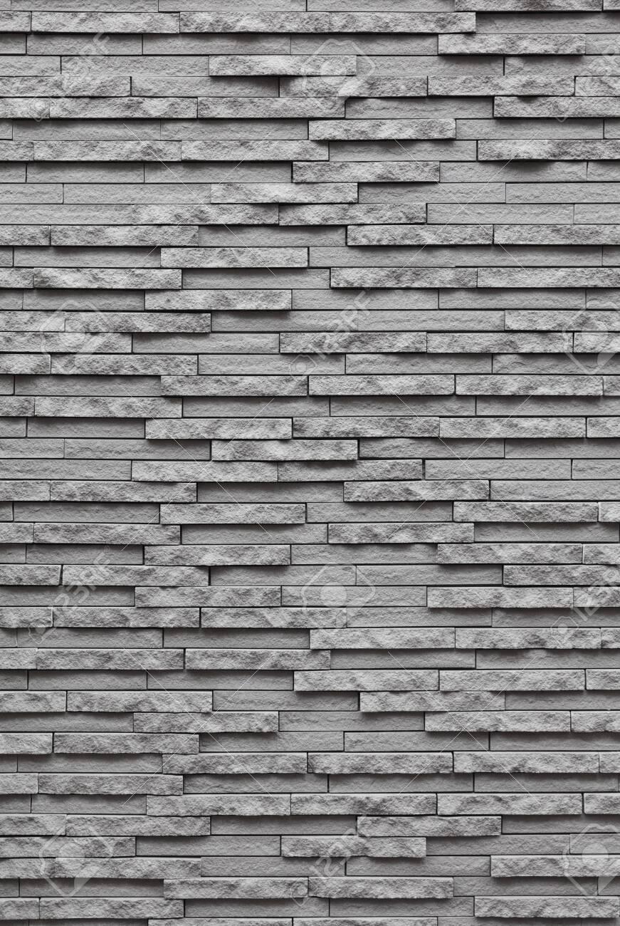 grey stone wall - 129191288