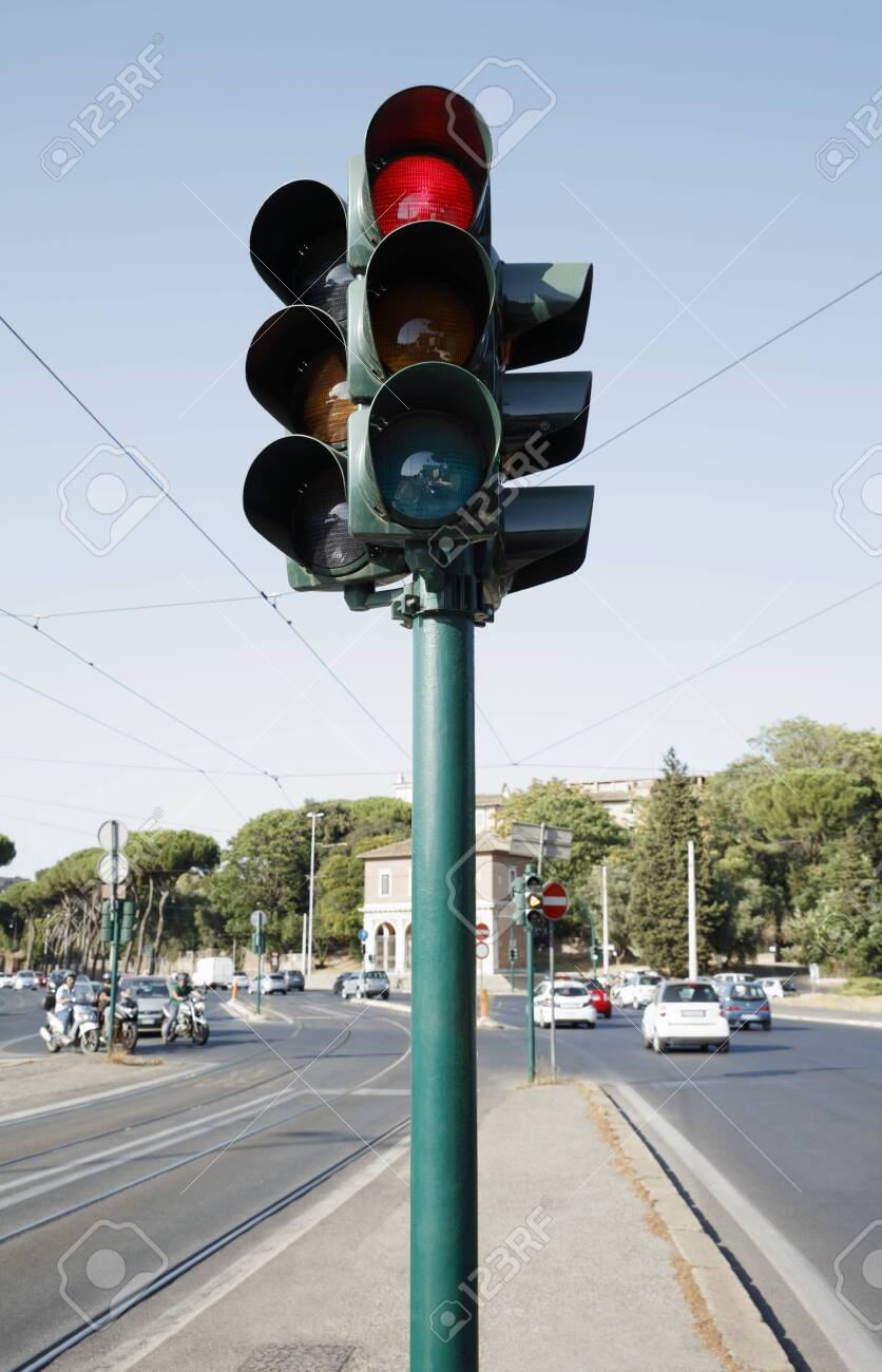 Traffic light standing on the road - 129192670