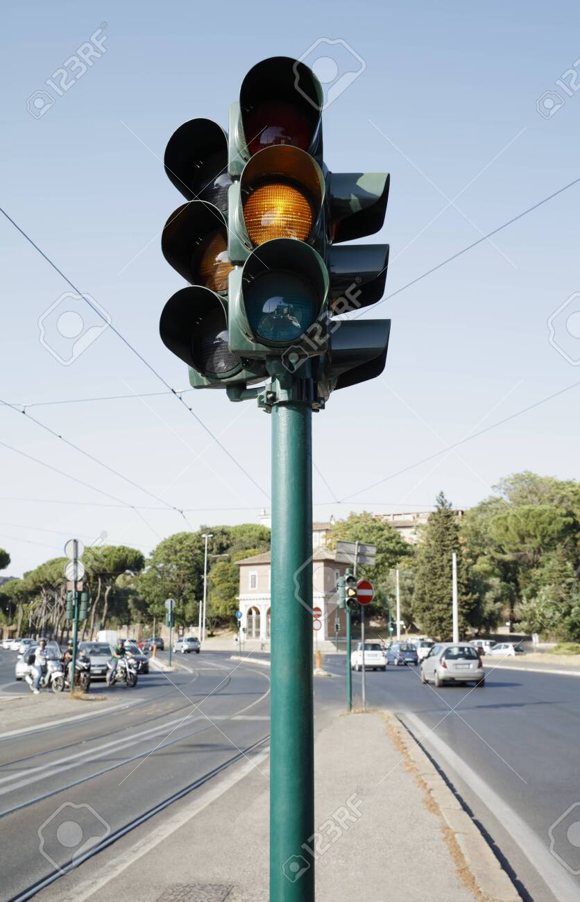 Traffic light standing on the road - 129193856