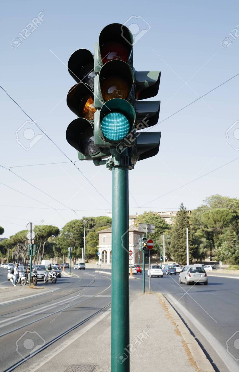 Traffic light standing on the road - 129193879