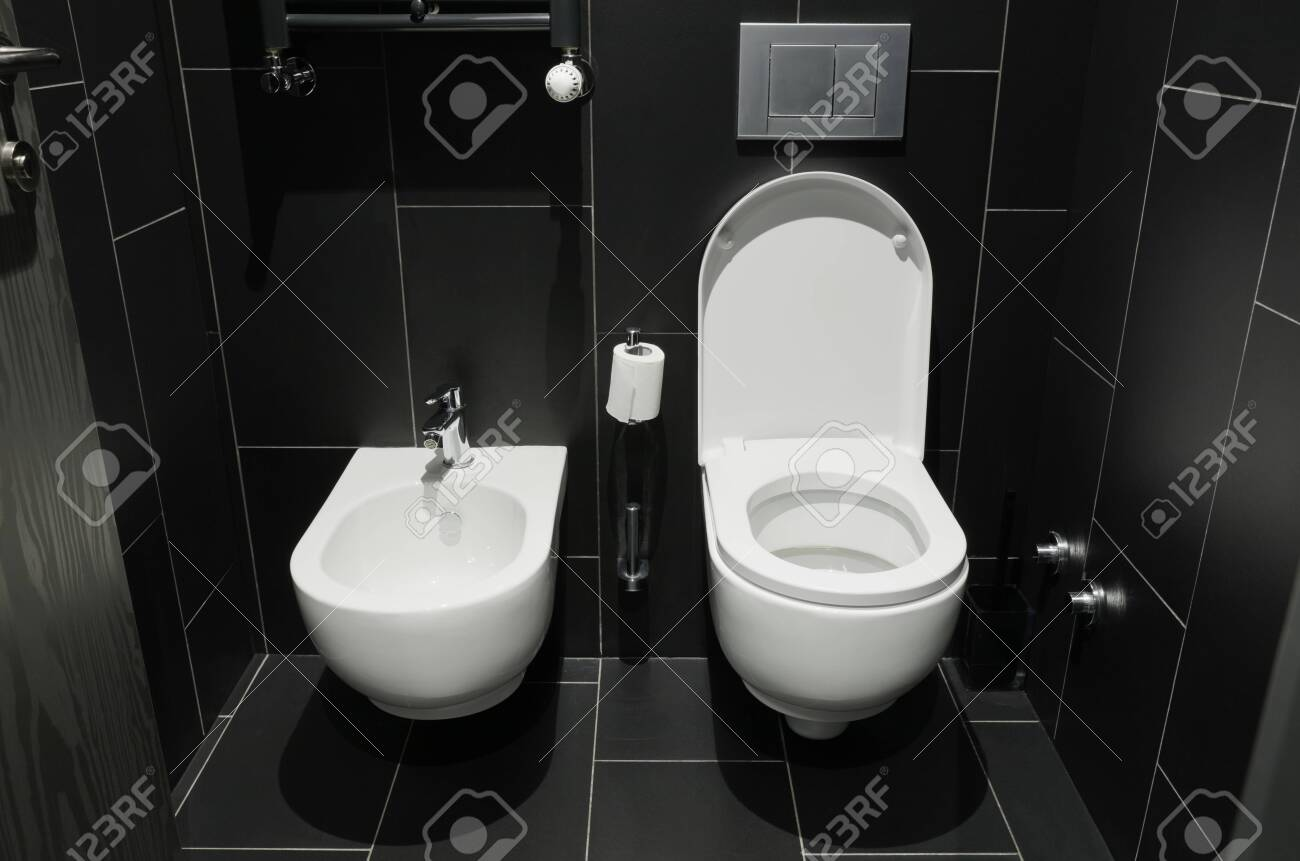White urinal of the toilet - 129196123