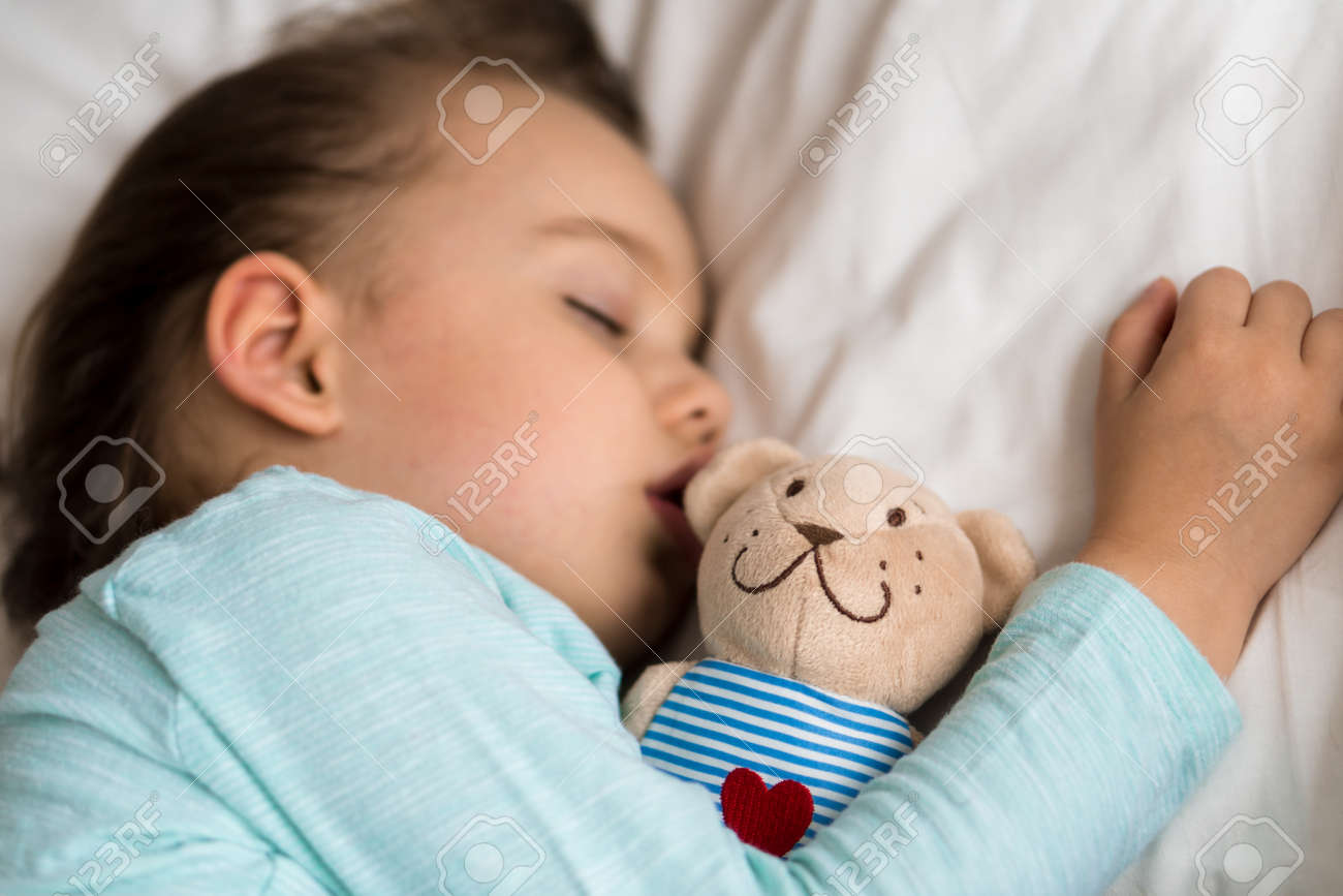 Authentic portrait sick cute caucasian little preschool baby boy in blue sleep with teddy bear on white bed. child resting at lunchtime. care, medicine and health, Childhood, Parenthood, life concept - 167122618