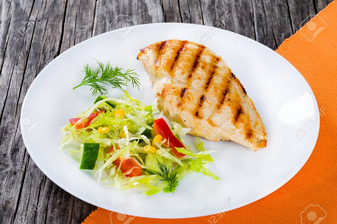 Healthy grilled chicken breast fillet with low calories spring
