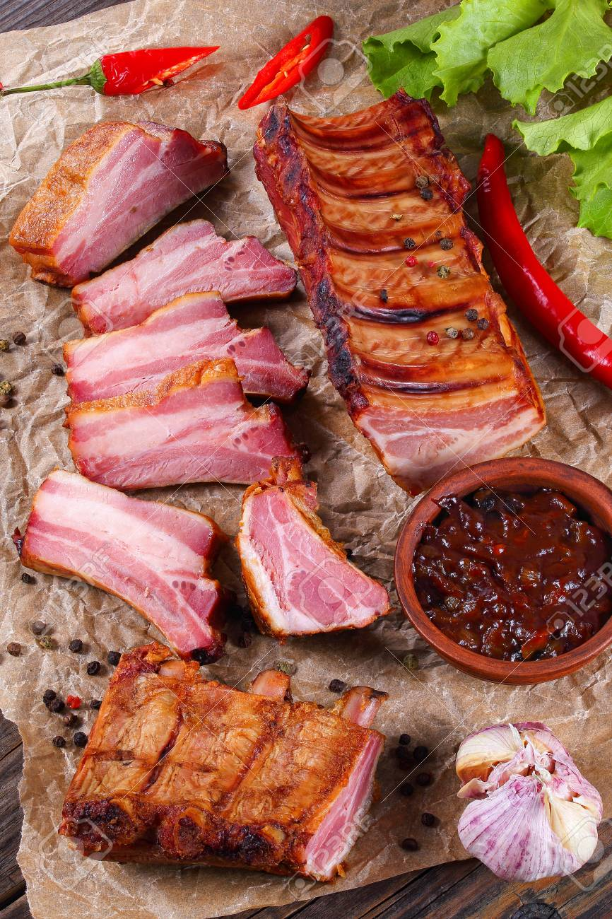 delicious smoked slab of pork ribs and rib slices with barbecue