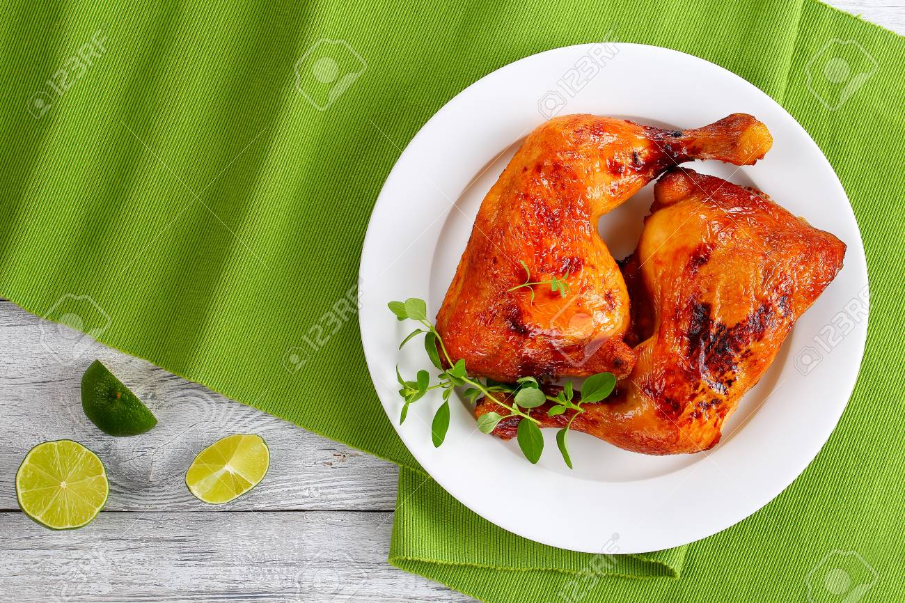 roasted chicken leg quarters with crispy golden brown skin with