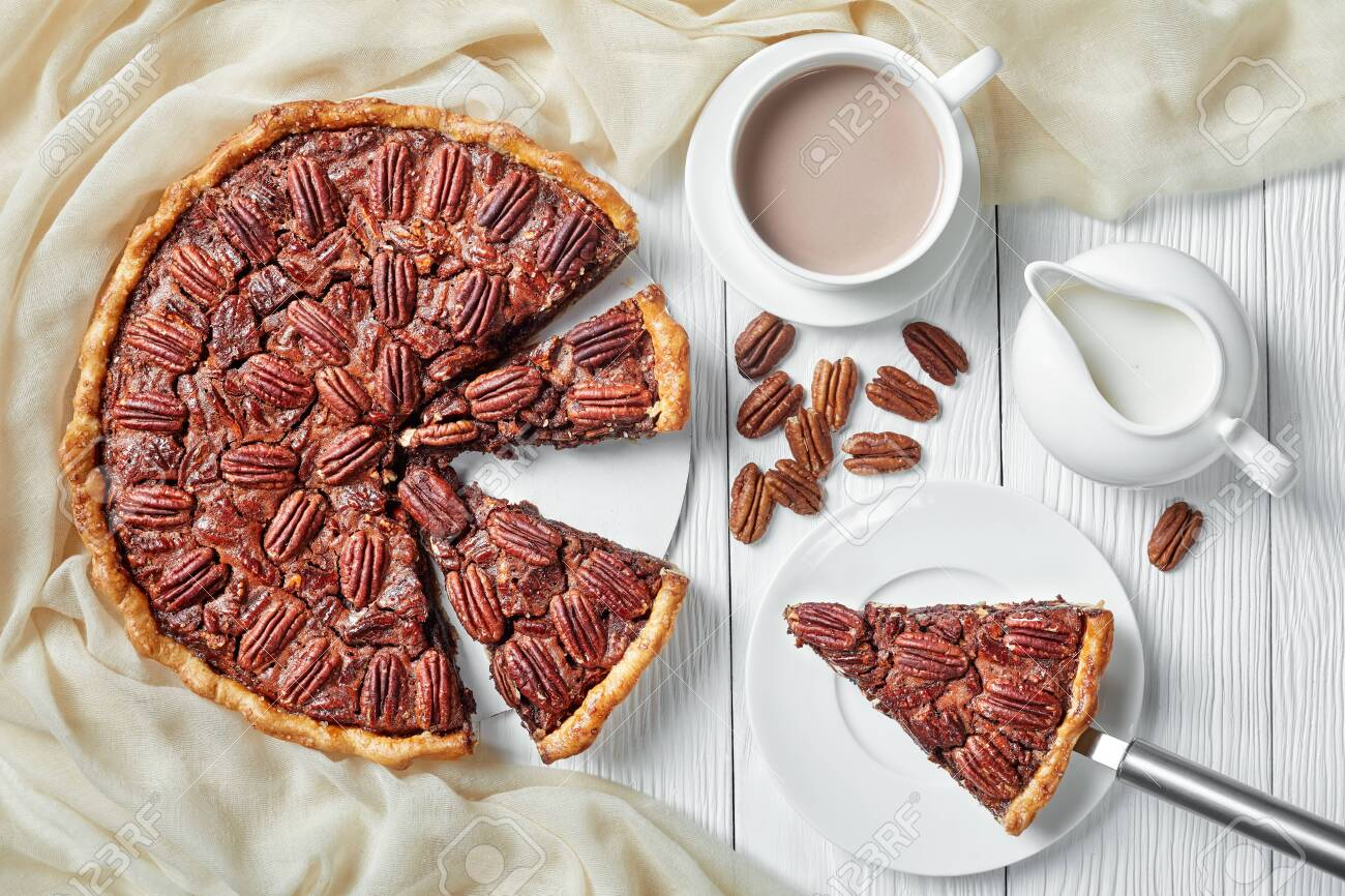 Pecan Pie Sliced On A White Platter Served With Hot Chocolate Stock Photo Picture And Royalty Free Image Image 135008948