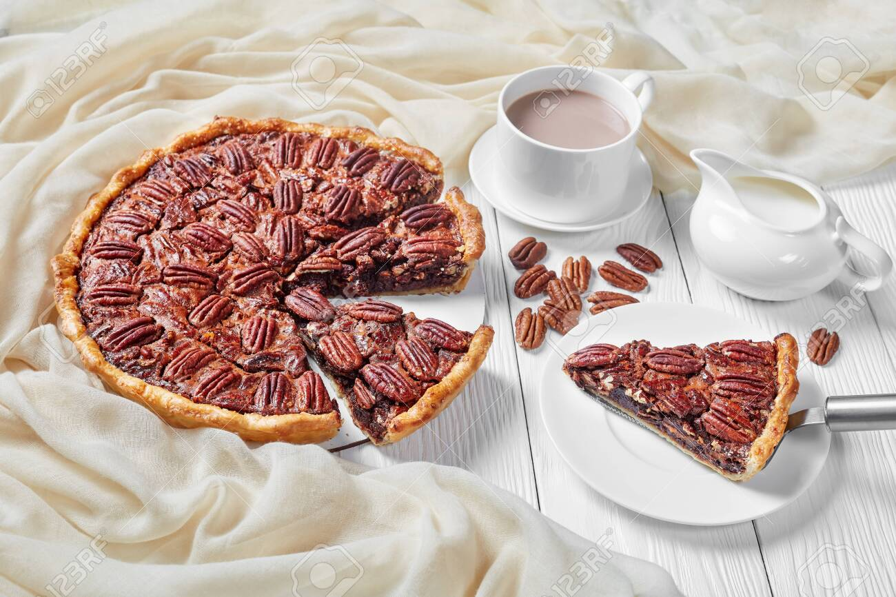 Pecan Pie Sliced On A White Platter Served With Hot Chocolate Stock Photo Picture And Royalty Free Image Image 135009014