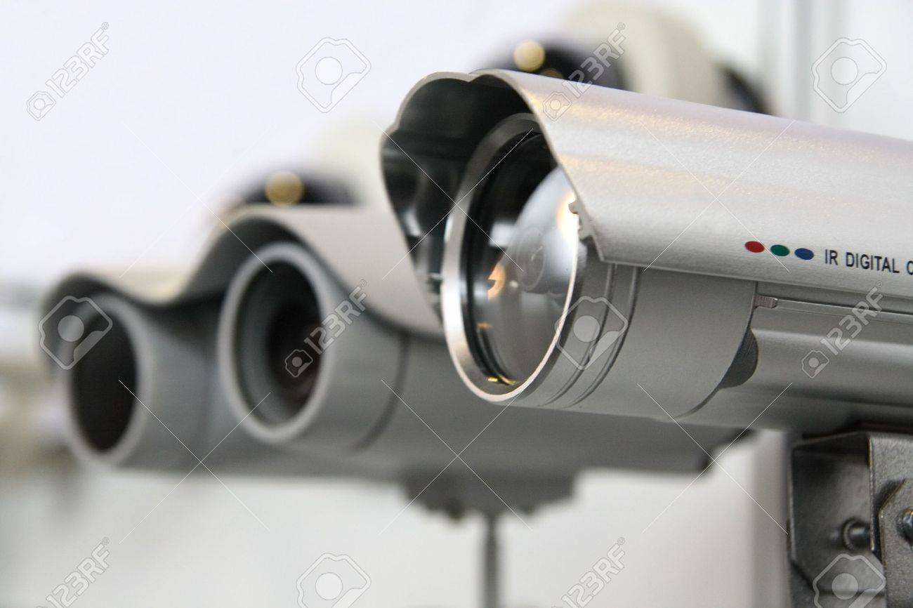 CCTV security cams on white wall background. Stock Photo - 2710834