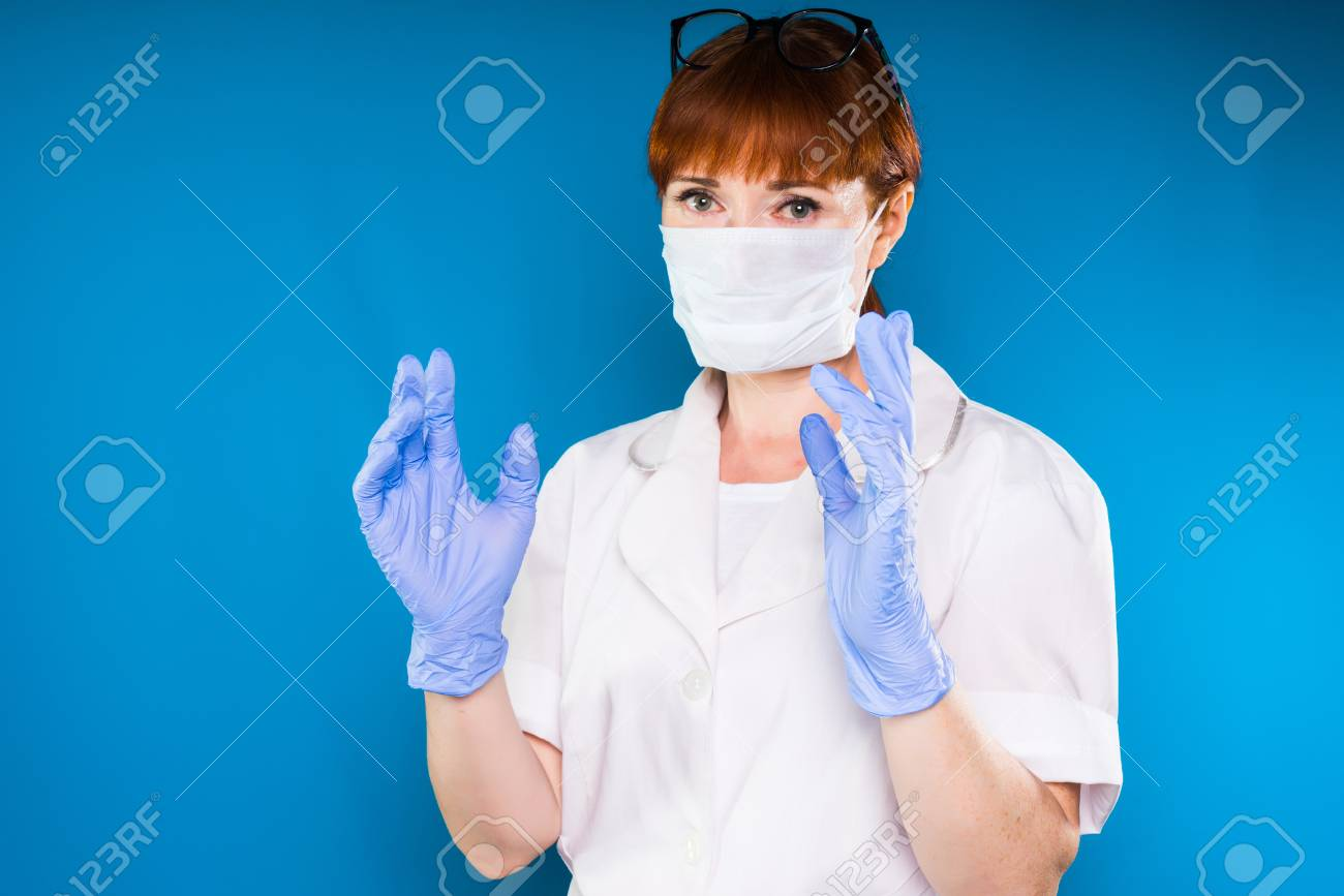 A Woman Surgeon In A Dressing Gown And Gloves Is Ready For Surgery ...