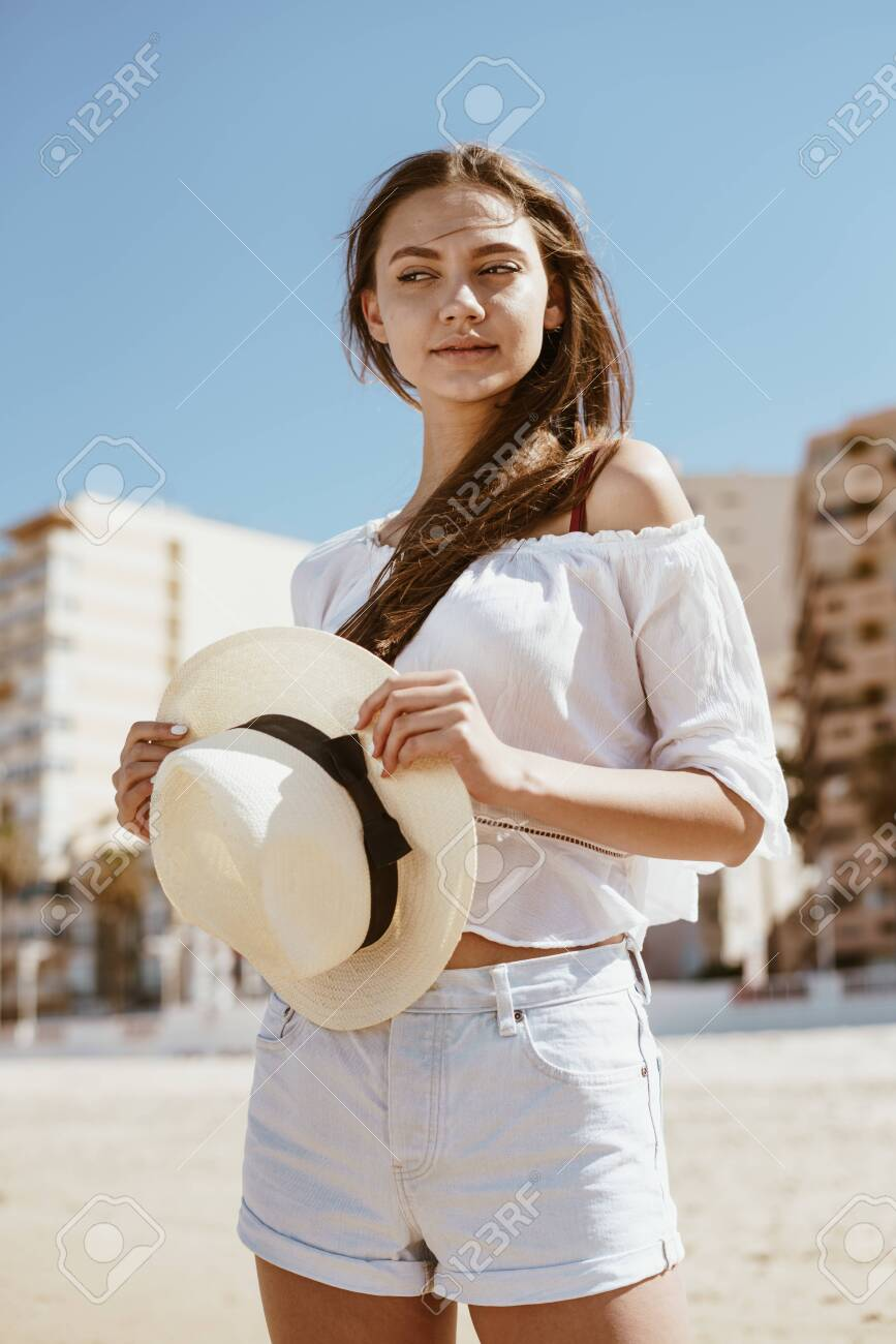 girl suspiciously mysteriously looks away on the beach - 132687827