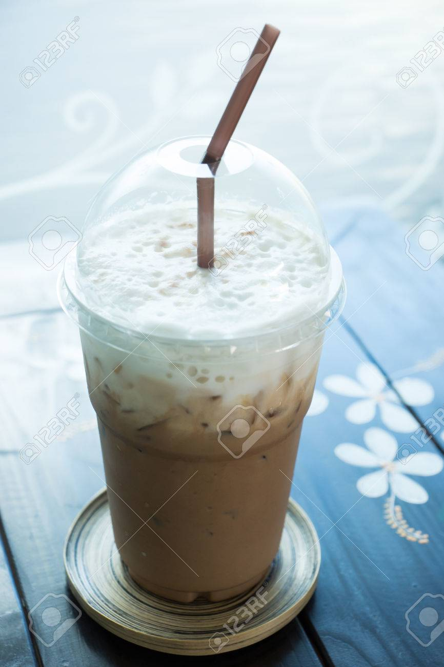 mocca ice coffee in plastic clear cup on table stock photo
