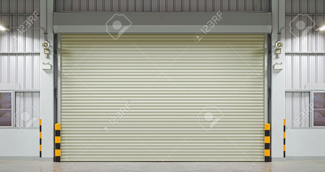 roller shutter door: Shutter door or rolling door night scene. & Roller Shutter Door Stock Photos \u0026 Pictures. Royalty Free Roller ... Pezcame.Com