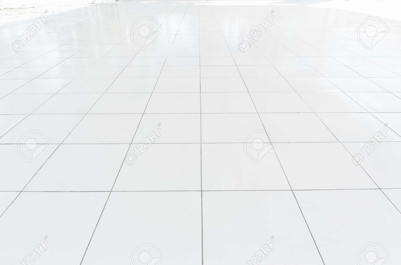 White tile floor clean condition with grid line for background. - 121279854