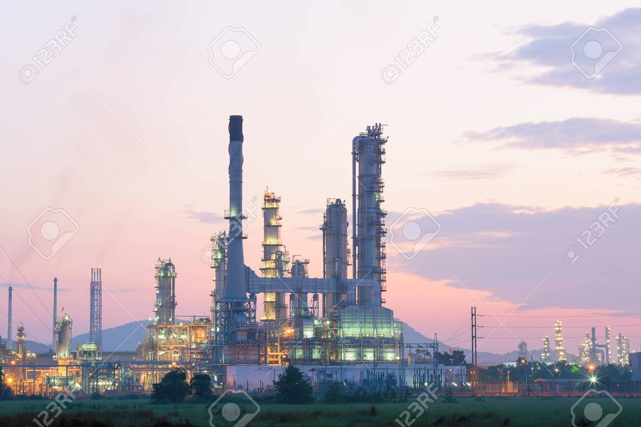 Oil refinery factory at processing work at twilight - 139629741