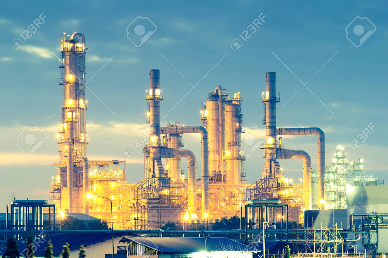 Oil refinery at twilight with sky background. - 141132391