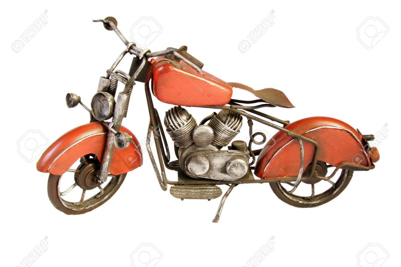 Old retro toy motorbike isolated on a white background Stock Photo - 17031205