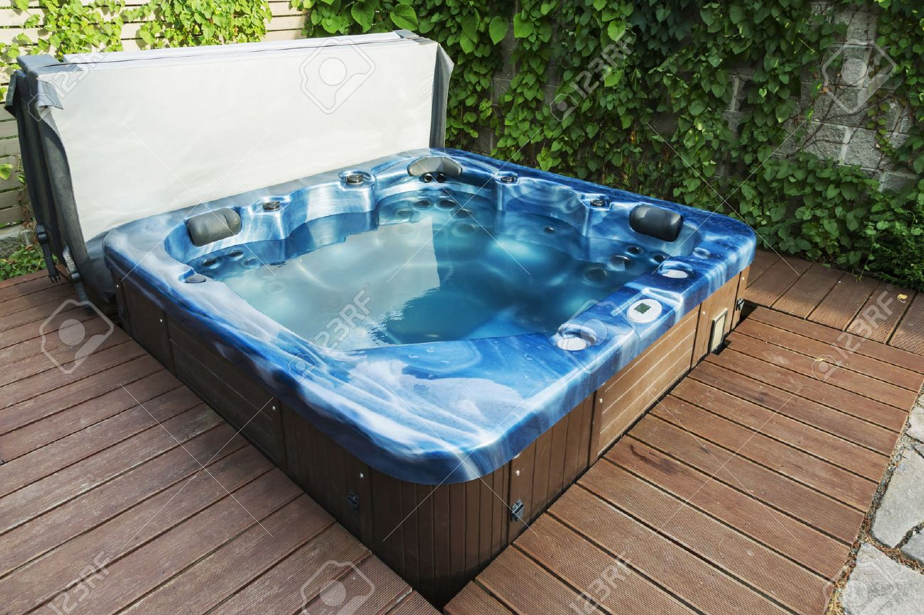 Outdoor Hot Tub, Jacuzzi On The Garden. Stock Photo, Picture And ...